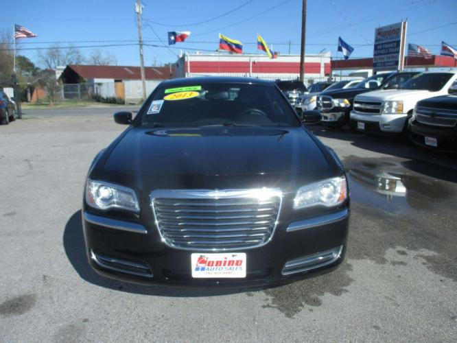 2013 BLACK CHRYSLER 300 (2C3CCAAG1DH) with an 3.6L engine, Automatic transmission, located at 830 E. Canino Rd., Houston, TX, 77037, (281) 405-0440, 38.358219, -81.729942 - Photo #0